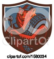 Clipart Of A Retro Woodcut Eurasian Brown Bear Mechanic Holding A Socket Wrench And Tire In A Shield Royalty Free Vector Illustration