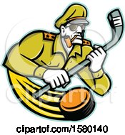 Tough Military Army General Sports Mascot Holding An Ice Hockey Stick With A Flying Puck