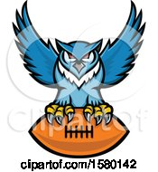 Clipart Of A Blue Great Horned Owl Sports Mascot Flying With An American Football Royalty Free Vector Illustration