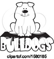 Clipart Of A Cartoon Black And White Happy Bulldog Sitting On Text Royalty Free Vector Illustration