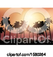 Silhouetted Palm Tree Orange Sunset Background