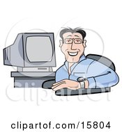 Friendly Male Computer Programmer Or Graphic Designer Seated In Front Of A Computer