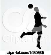 Clipart Of A Silhouetted Male Soccer Player Heading A Ball Over Gray With Text Space Royalty Free Vector Illustration