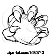 Clipart Of A Black And White Monster Claw Holding A Football Royalty Free Vector Illustration
