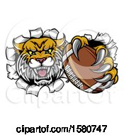 Clipart Of A Vicious Wildcat Mascot Breaking Through A Wall With A Football Royalty Free Vector Illustration by AtStockIllustration