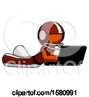 Poster, Art Print Of Orange Football Player Man Using Laptop Computer While Lying On Floor Side Angled View