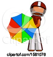 Orange Football Player Man Holding Rainbow Umbrella Out To Viewer