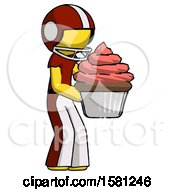 Yellow Football Player Man Holding Large Cupcake Ready To Eat Or Serve