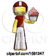 Yellow Football Player Man Presenting Pink Cupcake To Viewer