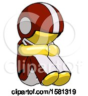 Yellow Football Player Man Sitting With Head Down Facing Angle Right