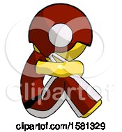 Yellow Football Player Man Sitting With Head Down Facing Sideways Right