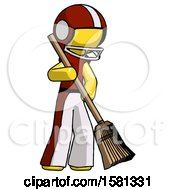 Yellow Football Player Man Sweeping Area With Broom