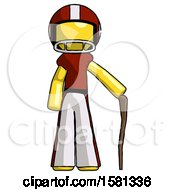 Yellow Football Player Man Standing With Hiking Stick