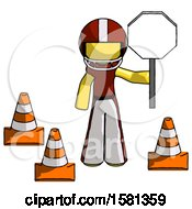 Yellow Football Player Man Holding Stop Sign By Traffic Cones Under Construction Concept