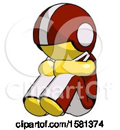 Yellow Football Player Man Sitting With Head Down Facing Angle Left