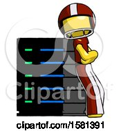 Yellow Football Player Man Resting Against Server Rack Viewed At Angle
