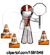 White Football Player Man Holding Stop Sign By Traffic Cones Under Construction Concept