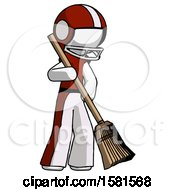 White Football Player Man Sweeping Area With Broom