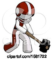 White Football Player Man Hitting With Sledgehammer Or Smashing Something At Angle