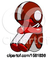 Red Football Player Man Sitting With Head Down Facing Angle Left