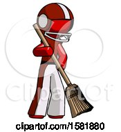 Red Football Player Man Sweeping Area With Broom