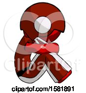 Red Football Player Man Sitting With Head Down Facing Sideways Right