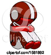 Red Football Player Man Sitting With Head Down Facing Angle Right