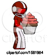 Red Football Player Man Holding Large Cupcake Ready To Eat Or Serve