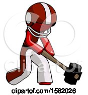 Red Football Player Man Hitting With Sledgehammer Or Smashing Something At Angle