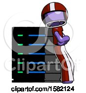Purple Football Player Man Resting Against Server Rack Viewed At Angle