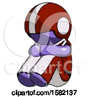 Purple Football Player Man Sitting With Head Down Facing Angle Left