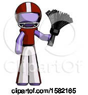 Purple Football Player Man Holding Feather Duster Facing Forward