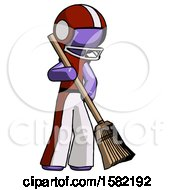 Purple Football Player Man Sweeping Area With Broom