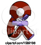 Purple Football Player Man Sitting With Head Down Facing Sideways Right