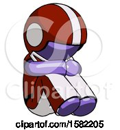 Purple Football Player Man Sitting With Head Down Facing Angle Right