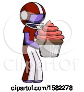 Purple Football Player Man Holding Large Cupcake Ready To Eat Or Serve