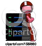 Pink Football Player Man Resting Against Server Rack Viewed At Angle