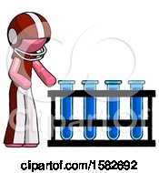 Pink Football Player Man Using Test Tubes Or Vials On Rack