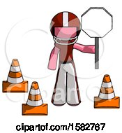 Pink Football Player Man Holding Stop Sign By Traffic Cones Under Construction Concept