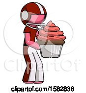 Pink Football Player Man Holding Large Cupcake Ready To Eat Or Serve
