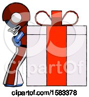 Blue Football Player Man Gift Concept Leaning Against Large Present
