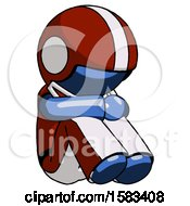 Blue Football Player Man Sitting With Head Down Facing Angle Right