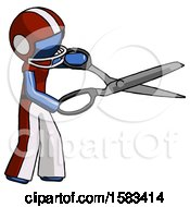 Blue Football Player Man Holding Giant Scissors Cutting Out Something