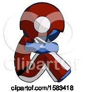 Blue Football Player Man Sitting With Head Down Facing Sideways Right
