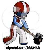 Blue Football Player Man Hitting With Sledgehammer Or Smashing Something At Angle