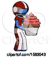 Blue Football Player Man Holding Large Cupcake Ready To Eat Or Serve