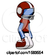 Blue Football Player Man Kneeling Angle View Right