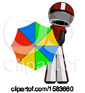 Black Football Player Man Holding Rainbow Umbrella Out To Viewer