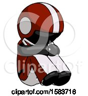Black Football Player Man Sitting With Head Down Facing Angle Right