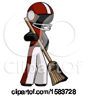Black Football Player Man Sweeping Area With Broom